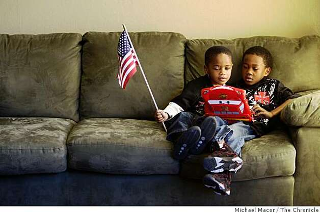DeShion Burrell, 4, (left) and Tavio Meeks, 6 share a video game during the inauguration of President Barack Obama during a viewing party at the Rare Touch II Hair Salon in Fremont, Calif., Tuesday Jan. 20, 2009. Photo: Michael Macor, The Chronicle