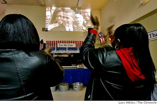 People celebrate as they watch the inauguration on President Barack Obama, Tuesday Jan. 20, 2009, at the Bayview Hunters Point Senior Center in San Francisco, Calif. Photo: Lacy Atkins, The Chronicle