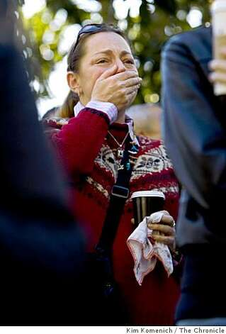 Gina Tiso of Santa Rosa reacts to the invocation as people gather to watch the inauguration of President-elect Barack Obama on two large television screens at Yerba Buena Gardens in San Francisco. Photo: Kim Komenich, The Chronicle
