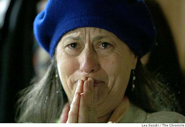 Alisa Rose Seidlitz of Berkeley cries as she watches coverage of the inauguration at Giovanna Tanzillo's inaugural viewing party at the Uptown Body and Fender shop in Oakland, Calif., on Tuesday January 20, 2009. Photo: Lea Suzuki, The Chronicle