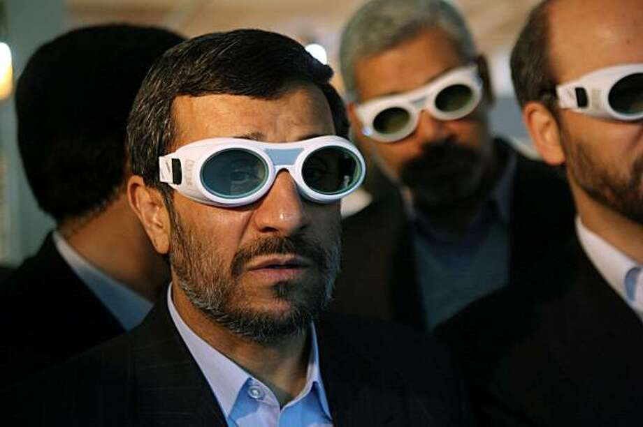 Iranian President Mahmoud Ahmadinejad, wears eye protection goggles as he visits an exhibition of Iran's laser science, in Tehran, Iran, Sunday, Feb. 7, 2010. Ahmadinejad ordered his country's atomic agency on Sunday to begin the production of higher enriched uranium, a move that's likely to deepen international skepticism about the country's real intentions on the crucial issue of enriched uranium. Photo: Ruzbeh Jadidoleslam, Mehr News Agency