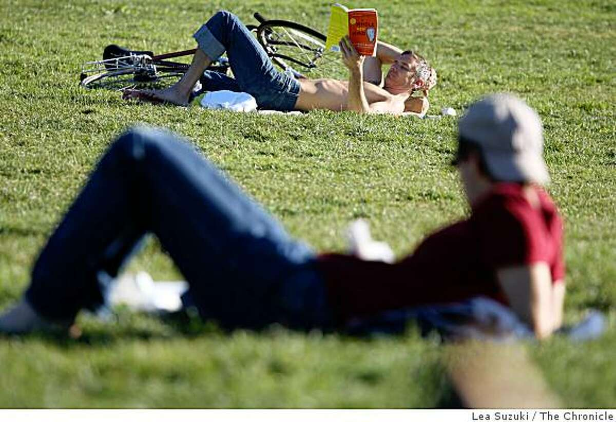 Brad McCully (top) of San Francisco, reads the book