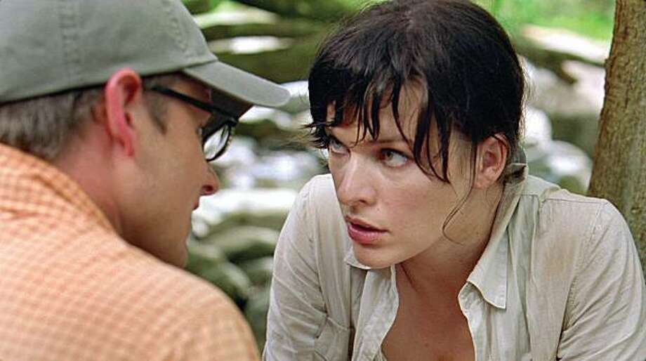 """In this film publicity image released by Universal Pictures, Milla Jovovich and Steve Zahn, left, are shown in a scene from """"A Perfect Getaway."""" Photo: Associated Press"""