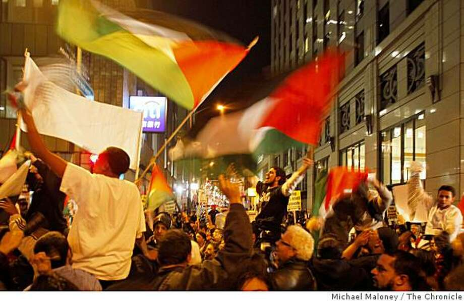 Bay Area activists protested outside the Israeli Consulate in San Francisco near Montgomery and Sacramento Streets in San Francisco Tuesday, December 30, 2008 with their flags and signs to protest the continuing Israeli offensive against Hamas while counter-demonstrators showed support for Israel. Photo: Michael Maloney, The Chronicle