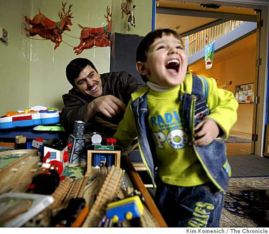 Mustafa Ghazwan, 3, right, and his father Ghazwan al-Nidawi play at the Ronald McDonald House in San Francisco. Photo: Kim Komenich, The Chronicle