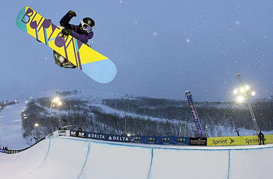 PARK CITY, UT - JANUARY 23:  Kelly Clark does an aerial above the halfpipe during practice as she went on to win the US Snowboarding Grand Prix on January 23, 2010 in Park City, Utah. Clark was named to the USA Snowboard Halfpipe Team for the 2010 Vancouver Winter Olympics. Photo: Doug Pensinger, Getty Images