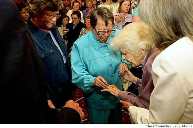 After 55 years Phyllis Lyon slips a wedding ring on Del Martins' finger during their wedding ceremony by Mayor Gavin Newson, Monday June 16, 2008, in San Francisco, Calif. Chronicle photo by Lacy Atkins. Photo: Lacy Atkins, The Chronicle