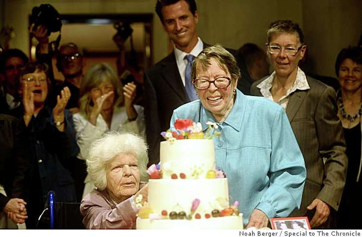 Phyllis Lyon, right, and Del Martin cut their wedding cake as Mayor Gavin Newsom watches on Monday, June 16, 2008, in San Francisco.