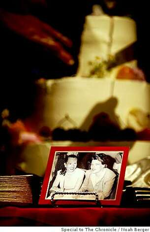 A photo of Phyllis Lyon and Del Martin rests in front of their wedding cake on Monday, June 16, 2008, in San Francisco.Photo by Noah Berger / Special to the Chronicle Photo: Noah Berger, Special To The Chronicle