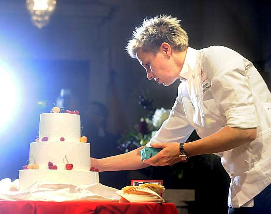 Elizabeth Falkner, owner of Citizen Cake, puts the finishing touches on a wedding cake shortly before the first same-sex marriage at San Francisco City Hall on Monday, June 16, 2008. Photo by Noah Berger / Special to the Chronicle Photo: Noah Berger, Special To The Chronicle
