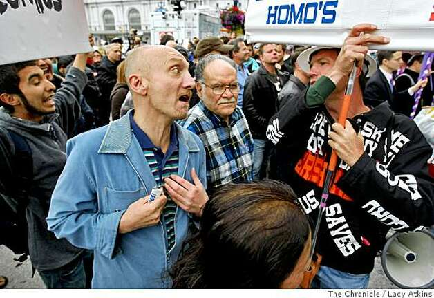 "George Simmons, left, sings ""God Loves Me and I am Gay"" as Bill Hampsmire of Christians for God protests same-sex marriage outside San Francisco City Hall on Monday, June 16, 2008 in San Francisco, Calif. Lacy Atkins /The San Francisco Chronicle Photo: Lacy Atkins, The Chronicle"