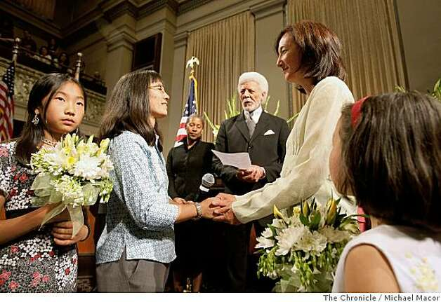 Akemi Hamai and Amy Haruyama are married by Oakland Mayor Ron Dellums as their daughters, Maya Haruyama and Anna Hamai join in the ceremony. Alameda County began issuing marriage certificates on Monday, June 16, 2008 in Oakland, Calif., after the historic May 15, 2008 ruling by the California Supreme Court that allowed same-sex couples to marry.Photo By Michael Macor/ The Chronicle Photo: Michael Macor, The Chronicle