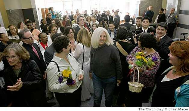 Couples gather in the lobby of the Alameda County Recorders office  waiting to be issued marriage certicates just after 5:00pm, as Alameda County began issuing marriage certificates on June 16, 2008 in Oakland, Calif., after the historic ruling by the California Supreme Court ruled May 15, 2008, that same-sex couples have a right to marry. Photo By Michael Macor/ The Chronicle Photo: Michael Macor, The Chronicle