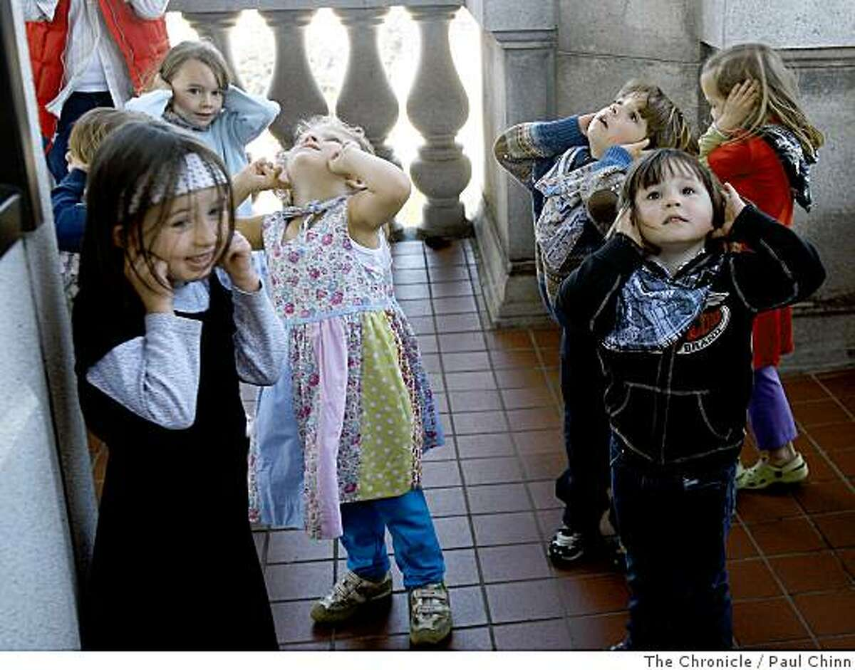 School children from Benvenue Children's House plug their ears as bells ring eleven times directly above them from Sather Tower in Berkeley, Calif., on Wednesday, June 4, 2008. The bell tower, also known as the Campanile, will host the Berkeley Carillon Festival from June 10 thru June 13 and is attracting carillonneurs from all over the world.Photo by Paul Chinn / The Chronicle