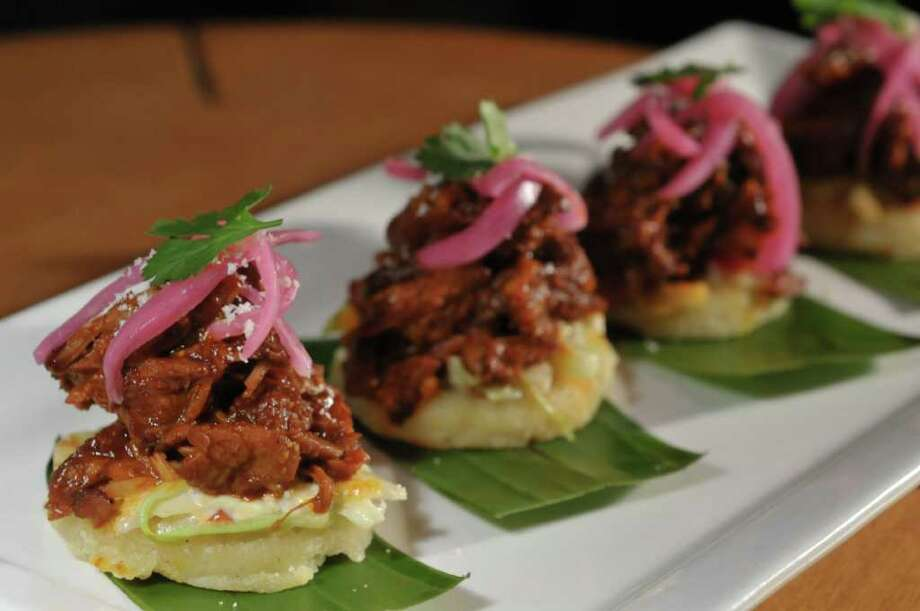 Barbecue pork arepas, a dish at the new Américas restaurant from chef Michael Cordua. Photo: Jack Opatrny / handout