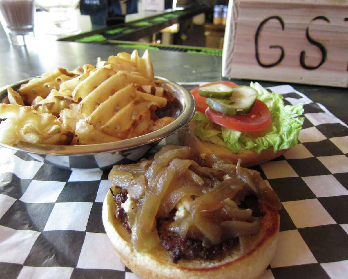 A burger with blue cheese spread and grilled onions at Gordon Street Tavern in Alvin. GST uses small, thin patties on its burgers and encourages you to stacks 'em for a bigger burger.