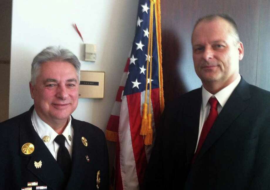 Mayor Michael Pavia appointed Antonio Conte, left, as the new Stamford Fire & Rescue Chief and Ted Jankowski, a 47-year-old native of Queens, N.Y., right, as the public safety director at news conference on Wednesday, Jan. 11, 2012. Photo: Jeff Morganteen / Stamford Advocate