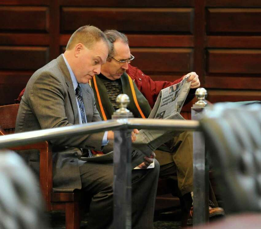 Reading the Times Union before the start of the court proceedings are Edward G. McDonough, left and Michael LoPorto two defendants in the ballot fraud case which is going on in Rensselaer County Court in Troy, New York Jan 11, 2012. (Skip Dickstein / Times Union)