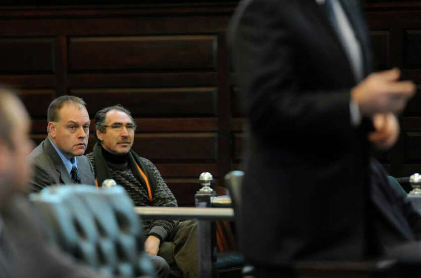 Sitting in court are Edward G. McDonough, left and Michael LoPorto two defendants in the ballot fraud case which is going on in Rensselaer County Court in Troy, New York Jan 11, 2012. (Skip Dickstein / Times Union)