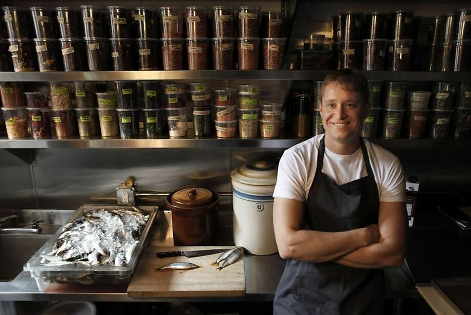 Nick Balla, standing in his Bar Tartine prep kitchen near shelves of spices, was brought up in Budapest. Photo: Carlos Avila Gonzalez, The Chronicle