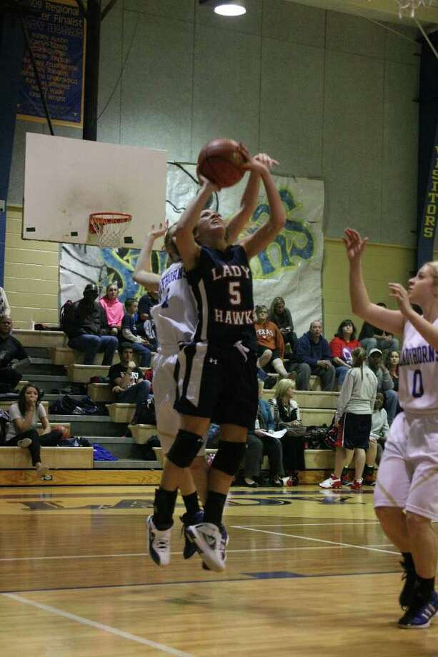 A matchup between two state ranked teams, the Hardin-Jefferson Lady Hawks (14) and the Hamshire Fannett Lady Longhorns (15) was an intense and physical game Tuesday night. By the final buzzer, the Lady Hawks had outscored the Lady Longhorns 49-44. Photo: David Lisenby, HCN_basketball 011012