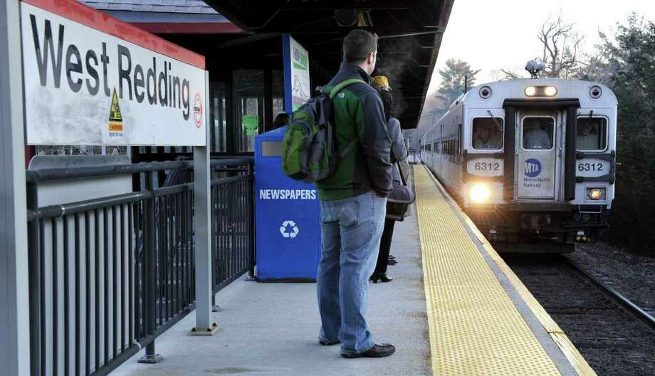 Passengers wait to board the 7:38 a.m. train bound for New York City at the West Redding train station Wednesday morning. Photo taken Wednesday, Jan. 11, 2012. Photo: Carol Kaliff