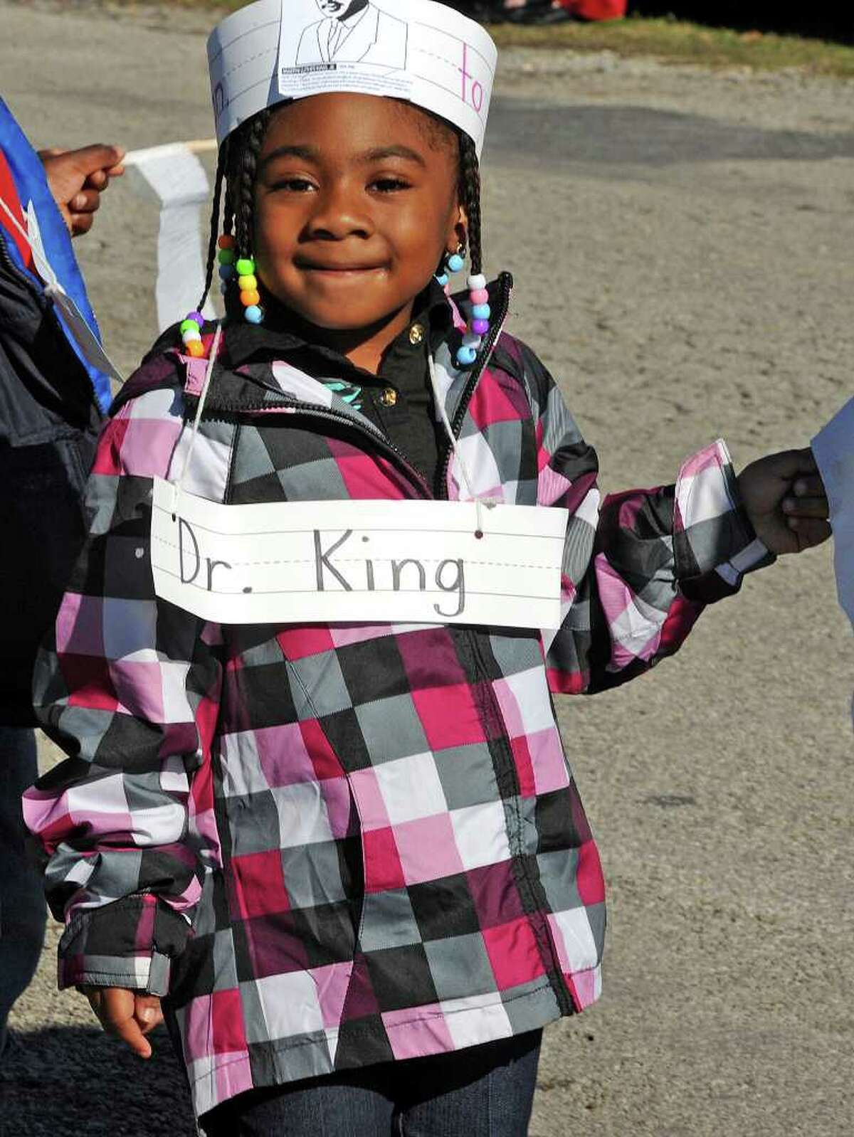 Southerland Head Start students march along Harriot Street Wednesday to celebrate the life of Martin Luther King and his upcoming birthday. Photo taken Wednesday, January 11, 2012 Guiseppe Barranco/The Enterprise
