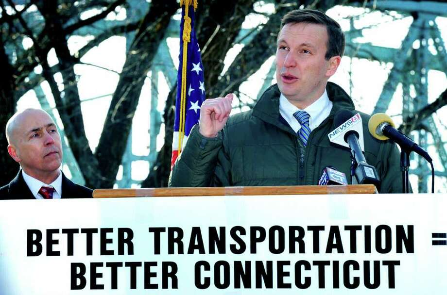 SPECTRUM/Congressman Chris Murphy (D-5th) addresses those on hand for a press conference in New Milford about cuts to federal transportation funding. He spoke near Veterans Memorial Bridge in New Milford, a bridge considered structurally deficient and in need of repair. Left is Don Shubert, president of Connecticut Construction Industries Association. Dec. 29, 2011. Photo: Carol Kaliff / The News-Times