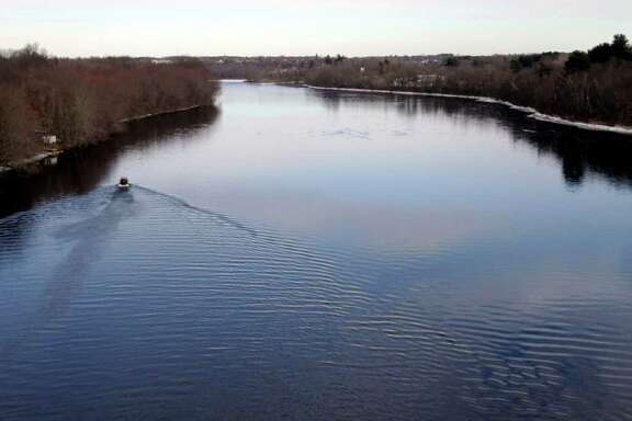 An airboat seaches searches the Kennebec River in Waterville,  Maine, on Wednesday, Jan. 11, 2012,  for 20-month-old Ayla Reynolds  who was reported missing since December. (AP Photo/Pat Wellenbach)