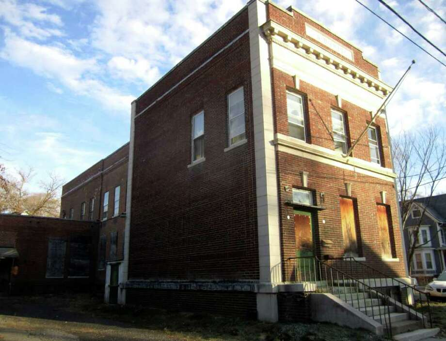 SPECTRUM/The town has agreed to sell venerable brick building on Church Street that has served as home to telephone company offices, a school and the New Milford Comunity Center (forerunner to Parks & Recreation). January 2012 Photo: Norm Cummings