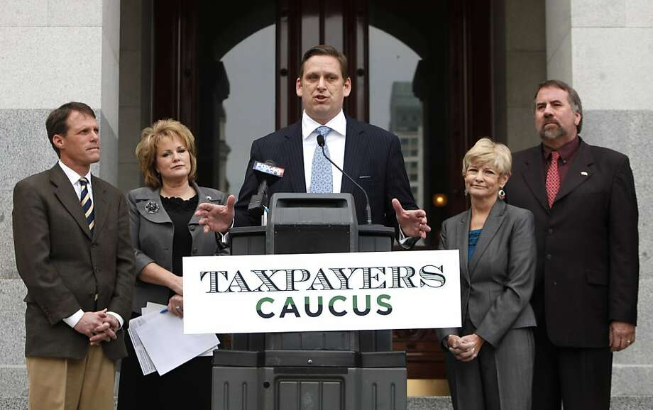 State Senator Tony Strickland, R-Thousand Oaks, center, discusses the newly formed Taxpayers Caucus during a news conference in Sacramento, Calif., Wednesday, Feb. 23, 2011.   The caucus, comprising GOP lawmakers from the Assembly and Senate, including State Sen. Ted Gaines, R-Granite Bay, left, Assemblywoman Shannon Grove, R-Bakersfield, second from left, state Sen. Sharon Runner, R-Lancaster, second from right, and Sen. Doug LaMalfa, R-Willows, say they will oppose any deal to close California's $26.6 billion budget deficit that involves tax increases. Photo: Rich Pedroncelli, AP