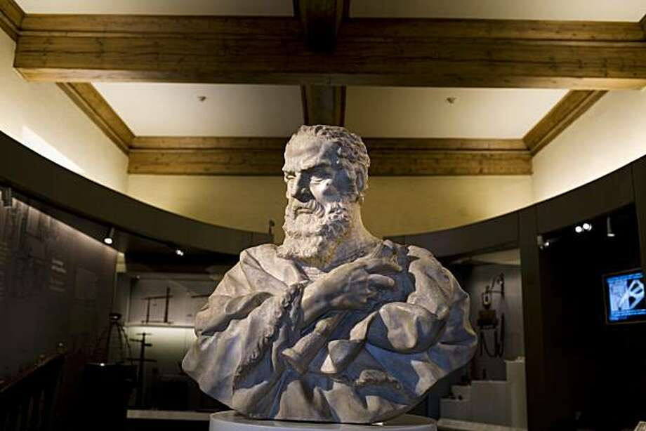 A bust of Galileo on display at the Galileo Museum in Florence, Italy, June 17, 2010. FlorenceÕs science museum, recently renovated and renamed to honor Galileo, has added three fingers and a molar sliced from Galileo's corpse nearly a century after he died, uniting them with another of the scientistÕs digits already in its collection. (Kathryn Cook/The New York Times) Photo: Kathryn Cook, NYT