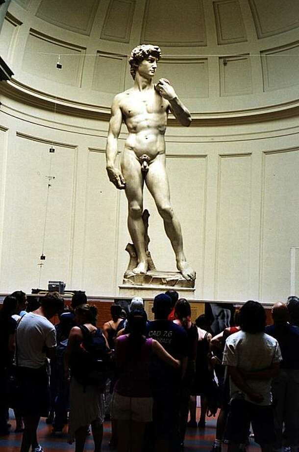 """NYT30) FLORENCE, Italy -- July 14, 2003 -- DAVID-STATUE-RESTORE -- Five centuries after Michelangelo's """"David'' was unveiled in Florence's Piazza della Signoria, there is another contretemps about how to save this icon of youthful beauty from the ravages of time. Should the marble colossus be restored to its original perfection or simply cleaned of grime? Or should it learn to live with the inevitable streaks and blotches of venerable old age? Michelangelo's """"David,'' in the Galleria dell'Accademia in Florence, Italy on July 7, 2003. (Alan Riding/The New York Times)*LITE* Photo: Alan Riding, NYT"""