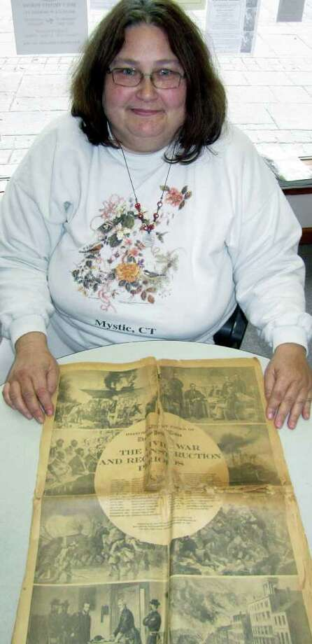 SPECTRUM/New Milford resident Diane Quarford shows off the mid-19th century specialedition New York Times she found in a family home. Photo: Contributed Photo