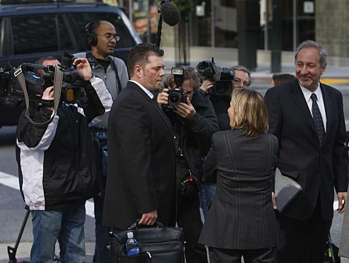 Greg Anderson and his attorneys Paula Canny and Mark Geragos (right) are surrounded by the media as they leave the Phillip Burton Federal Building after attending a pre-trial hearing for the perjury case against Barry Bonds in San Francisco on Tuesday. Anderson has repeatedly refused to testify in the case involving his close friend.