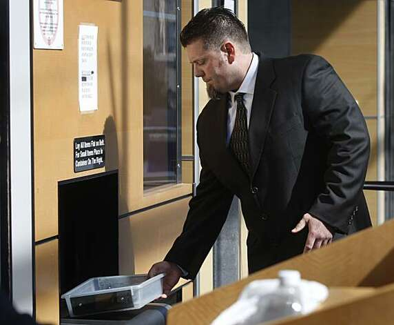 Greg Anderson goes through security screening at the Phillip Burton Federal Building, where he attended a pre-trial hearing for the perjury case against Barry Bonds in San Francisco on Tuesday. Anderson has repeatedly refused to testify in the case involving his close friend. Photo: Paul Chinn, The Chronicle