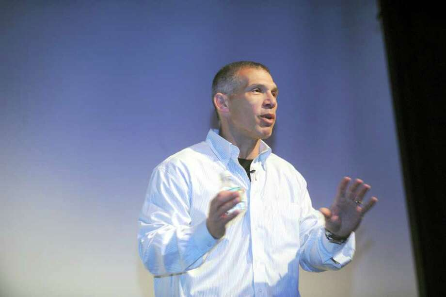 Manager of the New York Yankees Joe Girardi spoke to more than 300 Brunswick Upper School students recently at the school's Baker Theater. Girardi, a former Major League Baseball catcher, is the father of Dante Girardi, a student at Brunswick's Lower School. Photo: Helen Neafsey / Greenwich Time