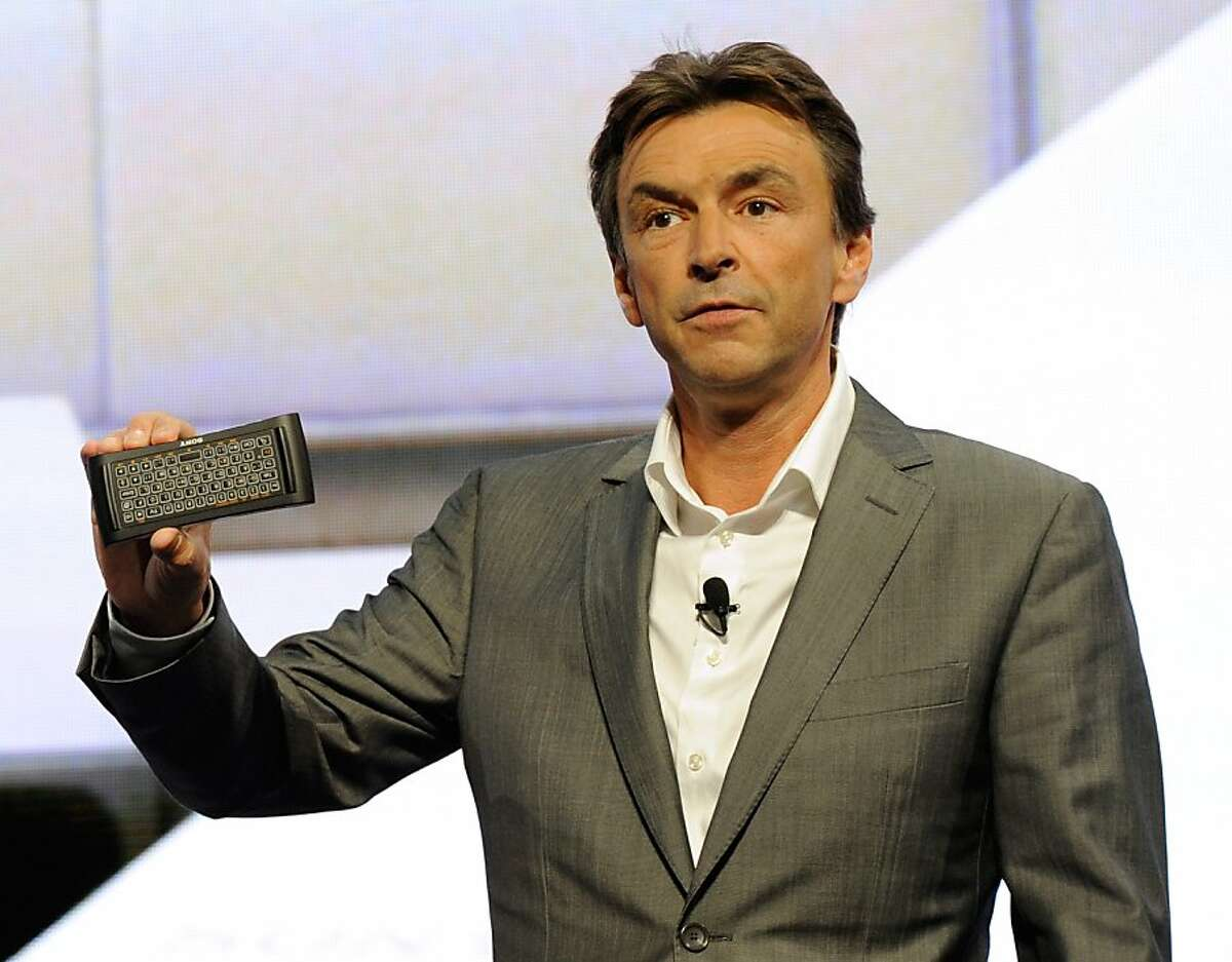 LAS VEGAS, NV - JANUARY 09: President and COO of Sony Electronics Inc. Phil Molyneux shows a new remote for Google TV devices during a Sony press event at the Las Vegas Convention Center for the 2012 International Consumer Electronics Show January 9, 2012 in Las Vegas, Nevada. CES, the world's largest annual consumer technology trade show, runs from January 10-13 and is expected to feature 2,700 exhibitors showing off their latest products and services to about 140,000 attendees. (Photo by Ethan Miller/Getty Images)