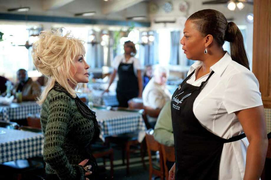 "Dolly Parton (left) and Queen Latifah are gospel choir rivals in ""Joyful Noise."" Photo: Warner Bros., Courtesy"