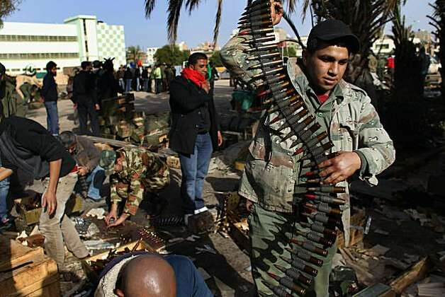 BENGHAZI, LIBYA - MARCH 01:  Rebel militia carry ammunition on March 1, 2011 in Benghazi, Libya. Supporters of the Libyan opposition, which controls Benghazi and most of eastern Libya, have been eager to join militia groups, which have been fighting the forces of President Muammar Gaddafi to the west near the capitol Tripoli. Photo: John Moore, Getty Images