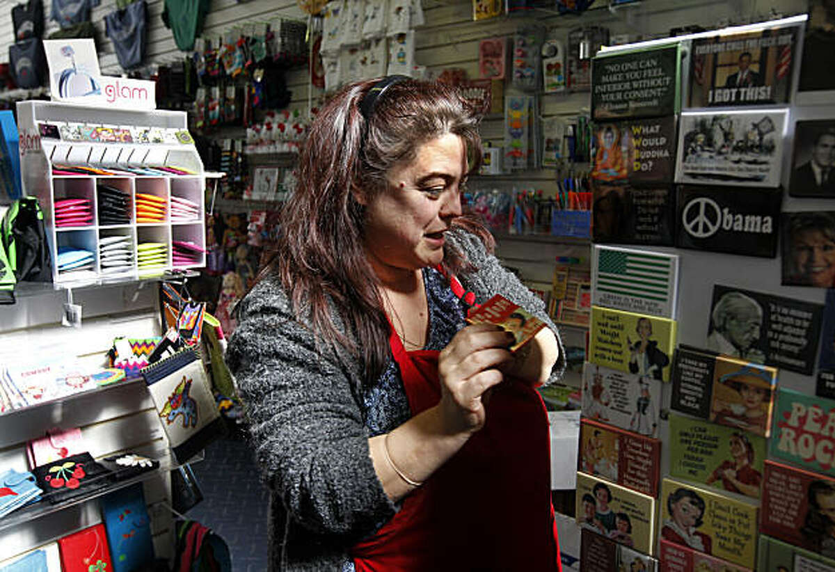 Store manager Shelly Alvarez arranges a display in the Greetings card shop in Berkeley, Calif., on Friday, Feb. 25, 2011. Local merchants are divided in their reactions over a proposed Goodwill thrift shop hoping to open on upper Solano Avenue. Alvarez welcomes the addition of a Goodwill store on the same block as her shop.
