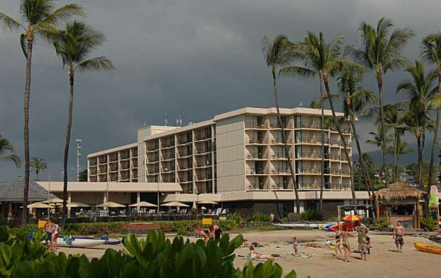King Kamehameha's Kona Beach Hotel fronts Kamakahonu Beach, where fresh water springs keep the cove water cool. Photo: Jeanne Cooper, Special To The Chronicle