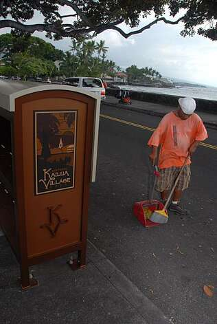 The merchants of Kailua-Kona have hired street cleaners and installed new publication kiosks to give the town a tidier image. Photo: Jeanne Cooper, Special To The Chronicle