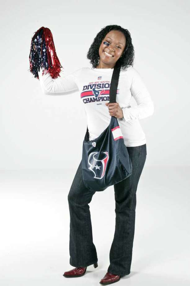 Texans fan A.J. Harris is wearing a Houston Texans ladies 2011 AFC South Division Champions long-sleeve T-shirt, $27.95, and Texans earrings, $14,  from the Go Texans store at Reliant Stadium. Photo: Michael Paulsen / © 2011 Houston Chronicle