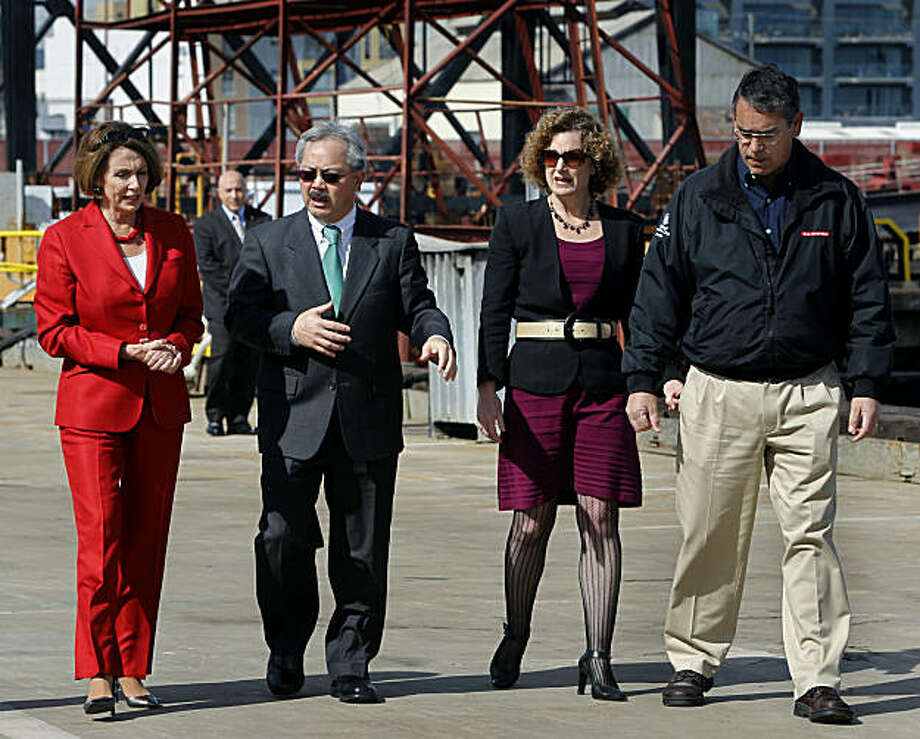 House Minority Leader Nancy Pelosi tours the dry dock and shipyard at Pier 70 with Mayor Ed Lee, Port of San Francisco executive director Monique Moyer and BAE Systems general manager Hugh Vanderspek in San Francisco on Saturday. The Democratic congressional leader discussed the importance of investing in infrastructure projects and job creation. Photo: Paul Chinn, The Chronicle