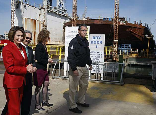 House Minority Leader Nancy Pelosi tours the dry dock and shipyard at Pier 70 with Mayor Ed Lee, Port of San Francisco executive director Monique Moyer and BAE Systems general manager Hugh Vanderspek in San Francisco on Saturday. Photo: Paul Chinn, The Chronicle