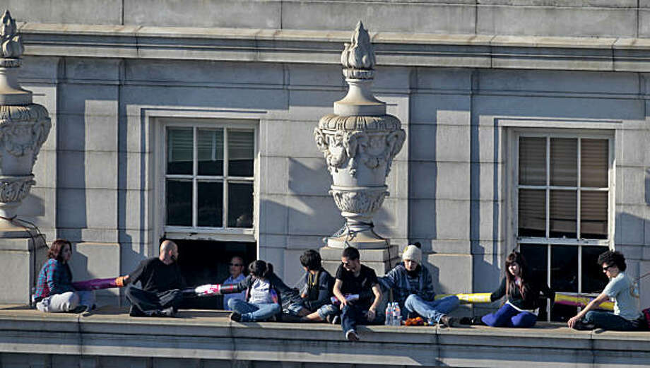 The nine students from UC Berkeley who chained themselves together and to Wheeler Hall talk to firefighters and UC Police through the window, Thursday, March 3, 2011,  in Berkeley, Calif.  The group was protesting tuition rate hikes. Photo: Lacy Atkins, The Chronicle