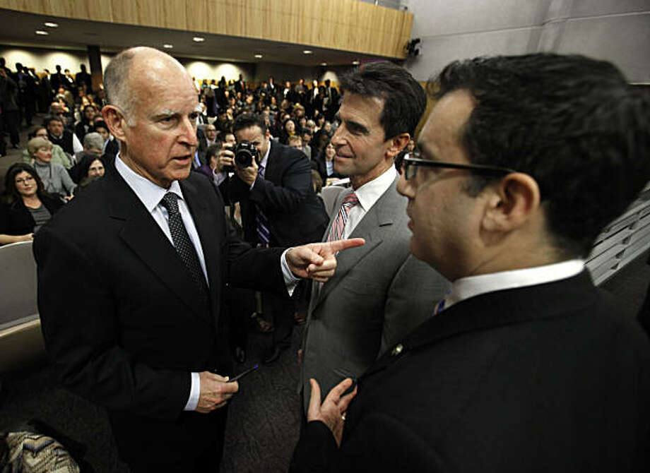 Gov. Jerry Brown, left, talks with Sen. Mark Leno, D-San Francisco, center, and Assemblyman Bob Blumenfield, D-Sherman Oaks, the co-chairs of the joint legislative budget conference committee at the Capitol  in Sacramento, Calif., Thursday, Feb. 24, 2011.Brown appeared before the committee to discuss his proposed budget plan. Photo: Rich Pedroncelli, AP