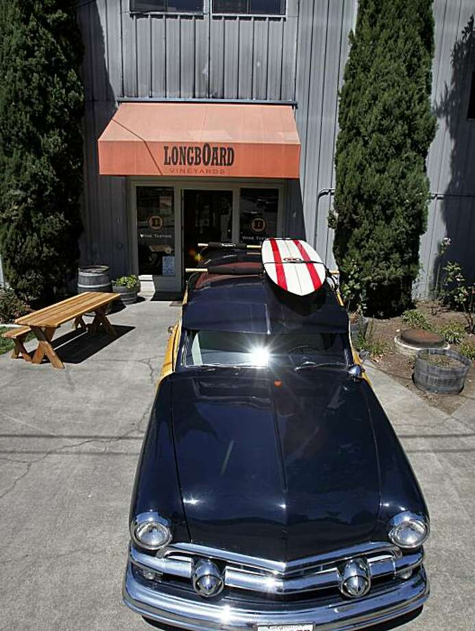 """A 1951 Ford """"Woody"""" has a place in front of the Longboard tasting room. The Longboard vineyards tasting room in Healdsburg, Calif. has a stunning collection of surfing memorabilia including many of the board actually used at the Mavericks competition. Photo: Brant Ward, The Chronicle"""