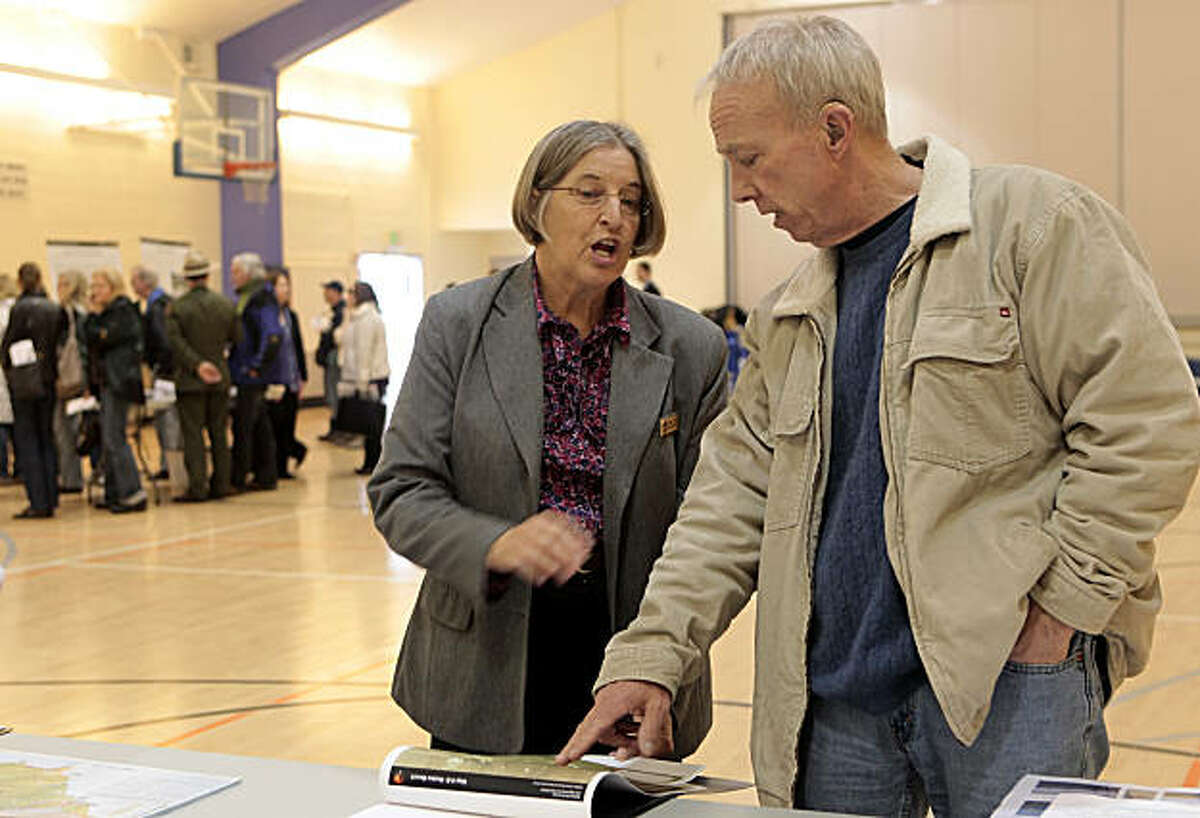 Daphne Hatch, Chief National Resource Management for the National Park Service, left, listens to Colin Michael Kitchens, of Larkspur, disagree with the Draft Plan/Draft Environmental Impact Statement (Plan/DEIS) for Dog Management, Wednesday March 2, 2011, in Mill Valley, Calif.